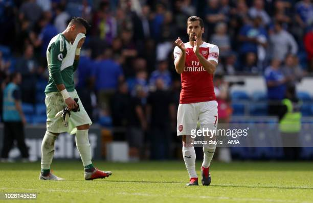 A dejected Neil Etheridge of Cardiff City walks past Henrikh Mkhitaryan of Arsenal who applauds the Arsenal supporters after the Premier League match...