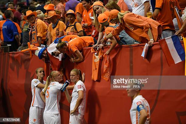 Dejected Netherlands players are consoled by Dutch fans after the FIFA Women's World Cup 2015 Round of 16 match between Japan and Netherlands at the...