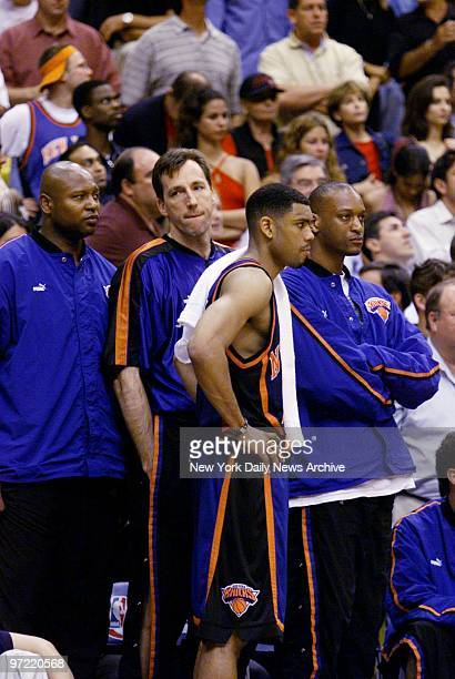 A dejected New York Knicks' bench consisting of Andrew Lang Chris Dudley Allan Houston and John Wallace watches as the seconds wind down on their...