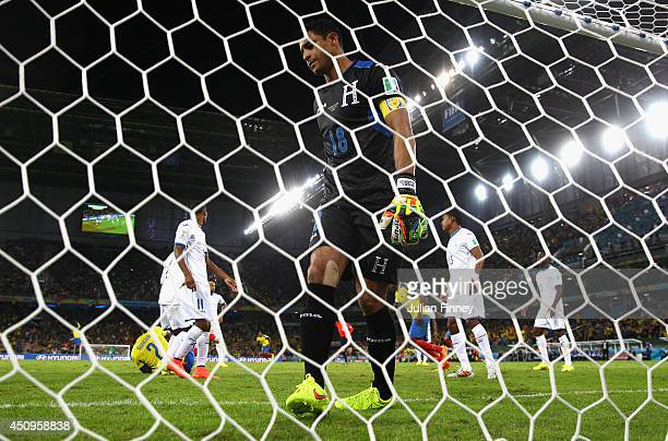 A dejected Noel Valladares of Honduras looks on after allowing Ecuador's second goal during the 2014 FIFA World Cup Brazil Group E match between...