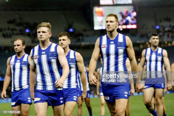 Dejected North Melbourne players walk from the ground after the round four AFL match between the North Melbourne Kangaroos and the Adelaide Crows at...