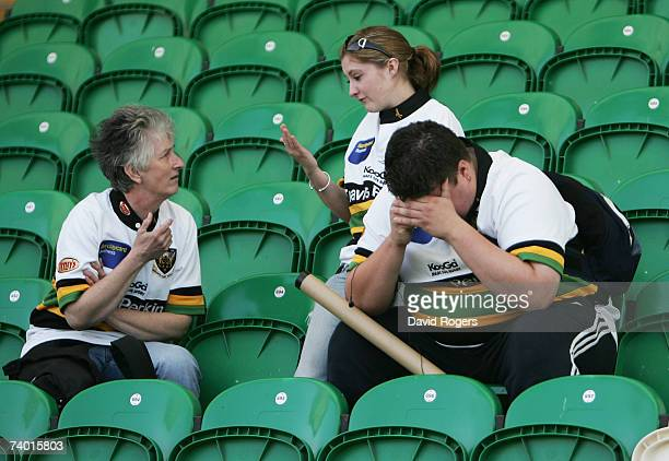 Dejected Northampton fans sit in the stands after seeing their team relegated from the Guinness Premiership following the Guinness Premiership match...