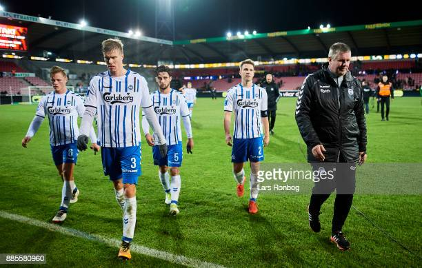 Dejected OB Odense players fr left Jeppe Tverskov Frederik Tingager Joao Pereira Kenneth Emil Petersen and Kent Nielsen head coach of OB Odense...