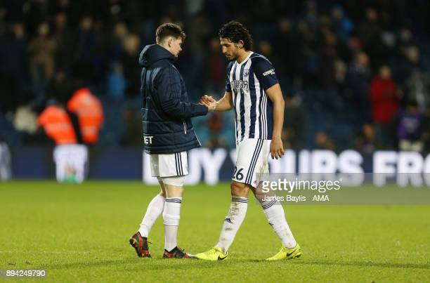 Dejected Oliver Burke of West Bromwich Albion and Ahmed Hegazy of West Bromwich Albion at full time during the Premier League match between West...