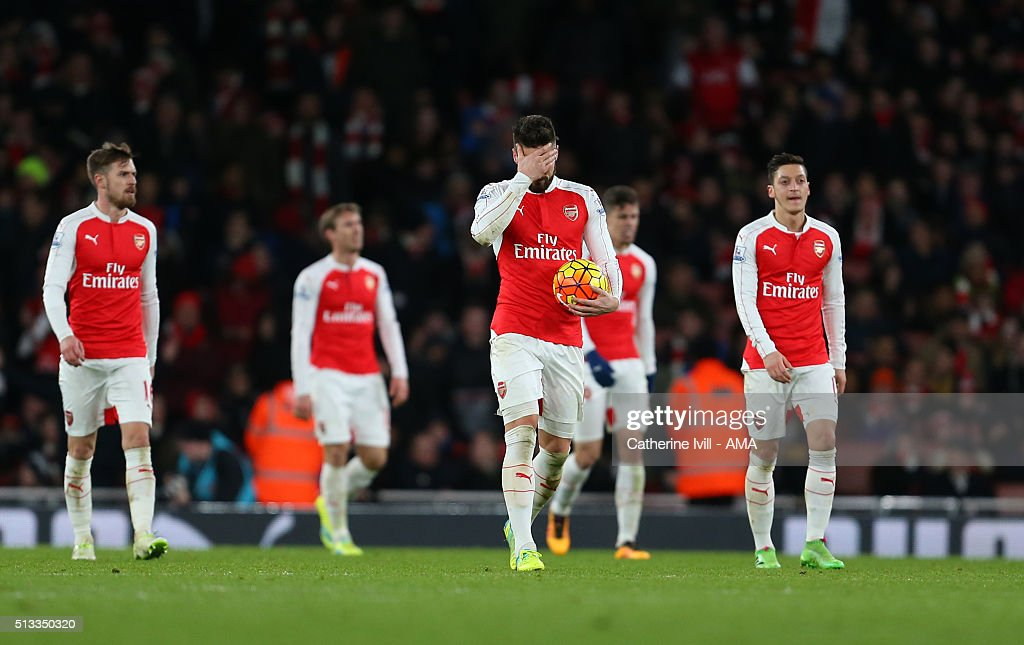 A dejected Olivier Giroud of Arsenal walks back with his team after Swansea City score to make it 1-2 during the Barclays Premier League match between Arsenal and Swansea City at the Emirates Stadium on March 02, 2016 in London, England.
