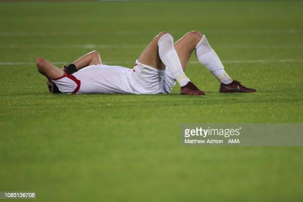 Dejected Omar Khrbin of Syria reacts at full time during the AFC Asian Cup Group B match between Australia and Syria at Khalifa Bin Zayed Stadium on...