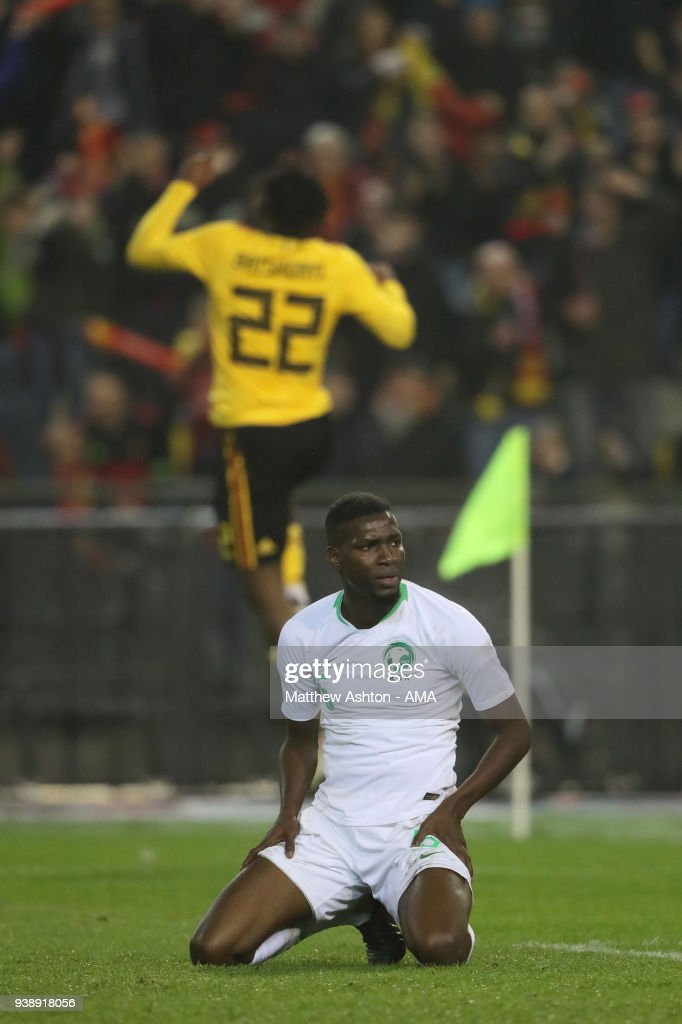A dejected Omar Othman of Saudi Arabia as Michy Batshuayi of Belgium celebrates after scoring a goal to make it 3-0 during an International Friendly between Belgium and Saudi Arabia on March 27, 2018 in Brussel, Belgium.