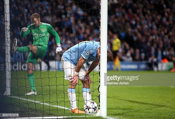 A dejected Pablo Zabaleta and Joe Hart of Manchester City after Daniel Alves of FC Barcelona scored a goal to make it 02