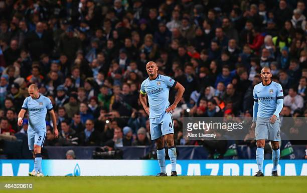 A dejected Pablo Zabaleta Vincent Kompany and Fernando of Manchester City look on during the UEFA Champions League Round of 16 match between...