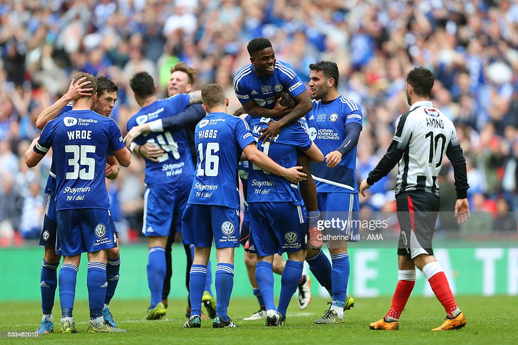 A dejected Padraig Amond of Grimsby Town walks past as Halifax Town celebrate the win after The FA Trophy Final match between Grimsby Town and Halifax Town at Wembley Stadium on May 22, 2016 in London, England.
