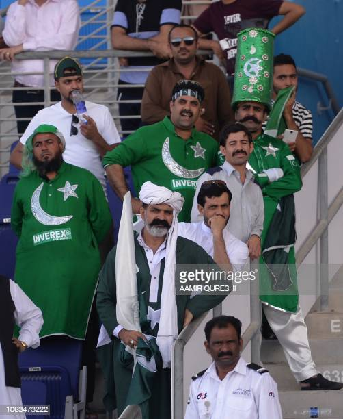 Dejected Pakistani cricket fans watch the award ceremony after New Zealand beat Pakistan in their first Test cricket match at the Sheikh Zayed...
