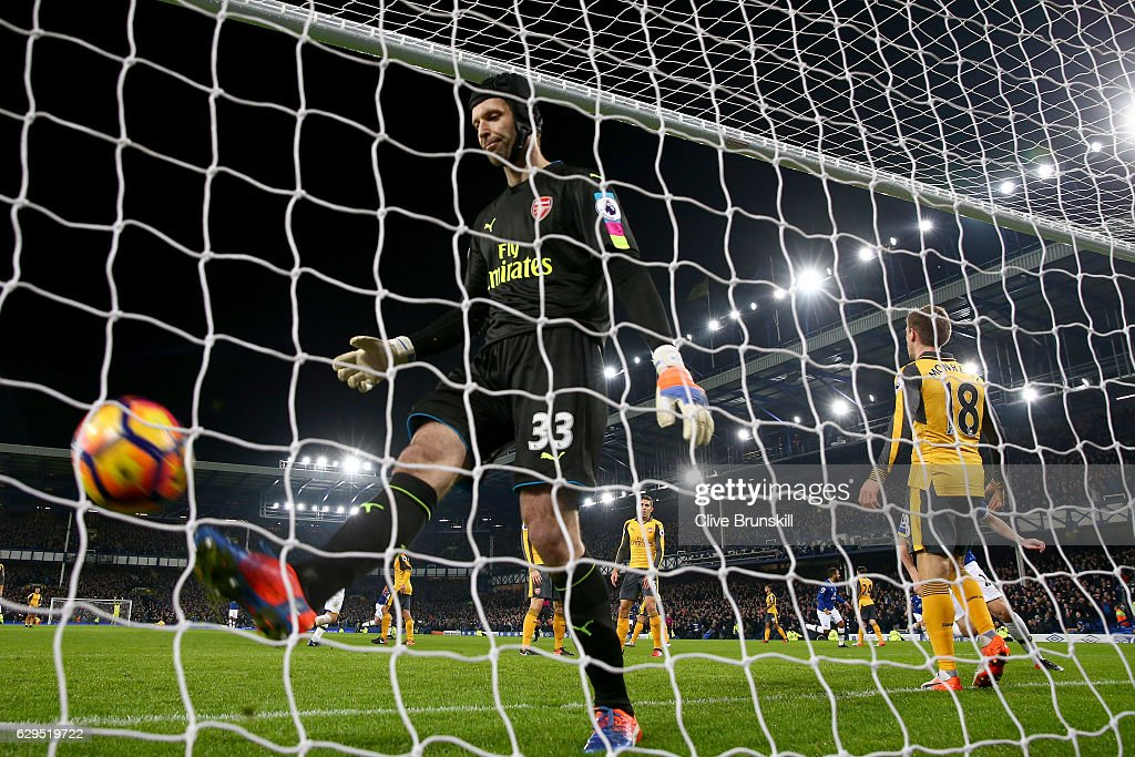 A dejected Petr Cech of Arsenal reacts after Seamus Coleman of Everton scores a goal to level the scores at 1-1 during the Premier League match between Everton and Arsenal at Goodison Park on December 13, 2016 in Liverpool, England.