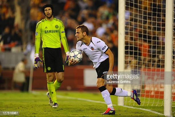 Dejected Petr Cech of Chelsea looks on as Roberto Soldado of Valencia celebrates scoring from the penalty spot during the UEFA Champions League Group...