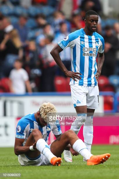 A dejected Philip Billing of Huddersfield Town and Adama Diakhaby of Huddersfield Town at full time during the Premier League match between...