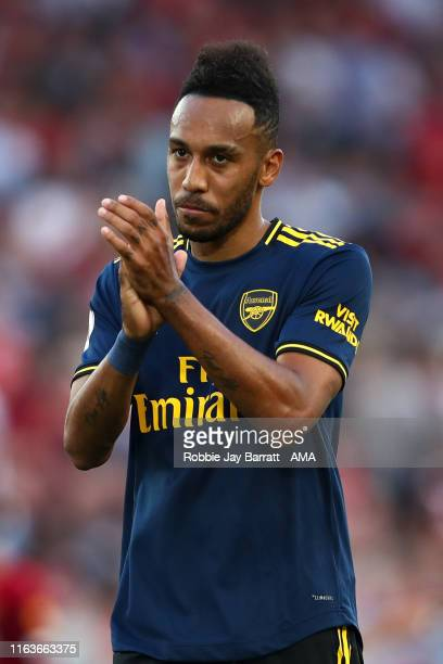 A dejected PierreEmerick Aubameyang of Arsenal applauds the fans at full time during the Premier League match between Liverpool FC and Arsenal FC at...
