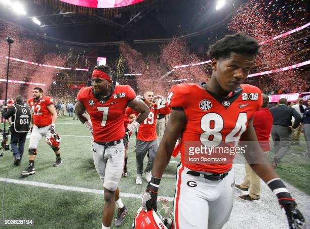 Dejected players Georgia Bulldogs linebacker Lorenzo Carter and Georgia Bulldogs linebacker Walter Grant leave the field after the College Football...