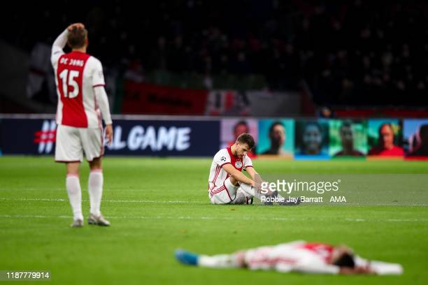 Dejected players of AFC Ajax react at full time during the UEFA Champions League group H match between AFC Ajax and Valencia CF at Amsterdam Arena on...