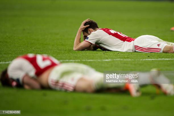 Dejected players of Ajax react at full time during the UEFA Champions League Semi Final second leg match between Ajax and Tottenham Hotspur at the...