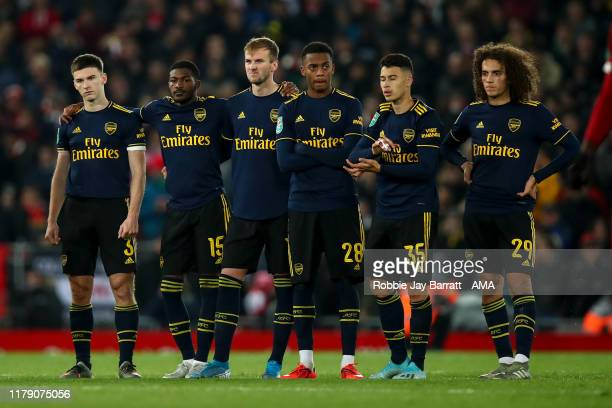 Dejected players of Arsenal look on during the Carabao Cup Round of 16 match between Liverpool and Arsenal at Anfield on October 30 2019 in Liverpool...