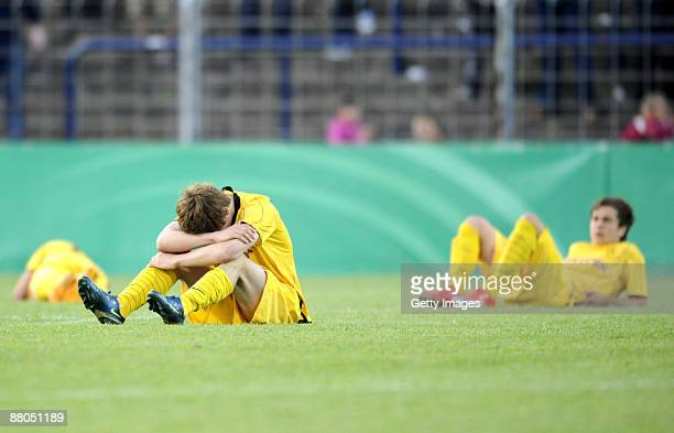 Dejected Players of Dortmund are seen after the DFB Juniors Cup final match between SC Freiburg and Borussia Dortmund at the KarlLiebknecht stadium...