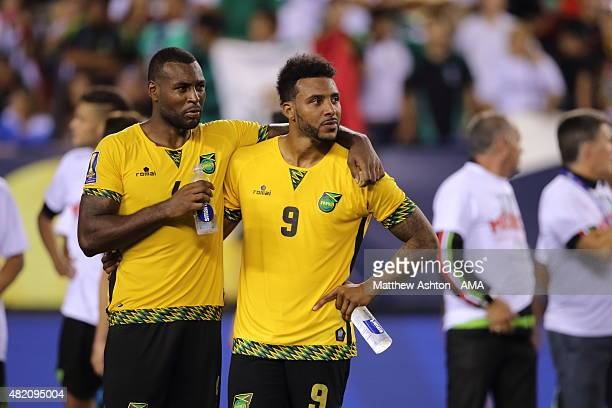 Dejected players Wes Morgan of Jamaica and Giles Barnes of Jamaica after the 2015 CONCACAF Gold Cup Final match between Jamaica and Mexico at Lincoln...