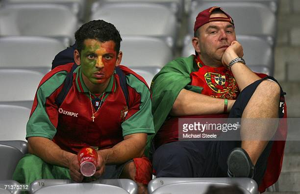 Dejected Portuguese fans look on from the stands following their team's 10 defeat and exit from the competition during the FIFA World Cup Germany...