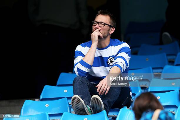 Dejected QPR fan reacts as his team is relegated following the final whistle during the Barclays Premier League match between Manchester City and...
