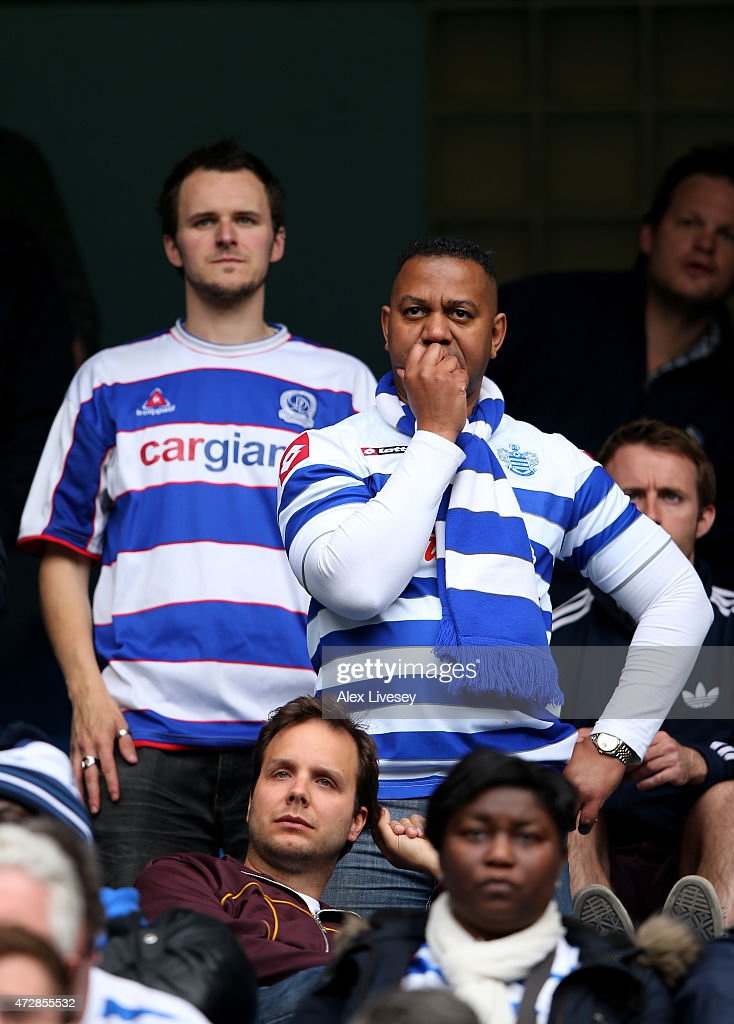 Dejected QPR fans react as their team is relegated following the final whistle during the Barclays Premier League match between Manchester City and Queens Park Rangers at the Etihad Stadium on May 10, 2015 in Manchester, England.