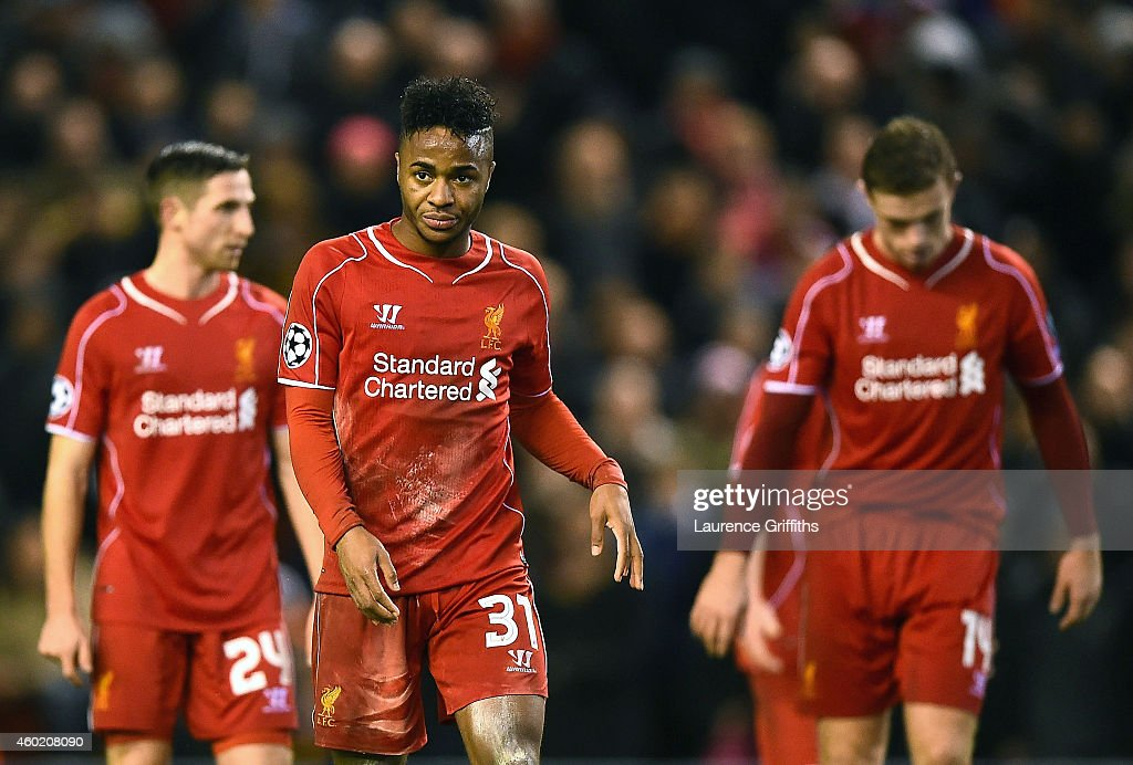 A dejected Raheem Sterling #31 of Liverpool and teammates walk off the pitch following their team's 1-1 draw and exit from the competition during the UEFA Champions League group B match between Liverpool and FC Basel 1893 at Anfield on December 9, 2014 in Liverpool, United Kingdom.