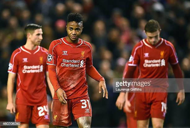 A dejected Raheem Sterling of Liverpool and teammates walk off the pitch following their team's 11 draw and exit from the competition during the UEFA...