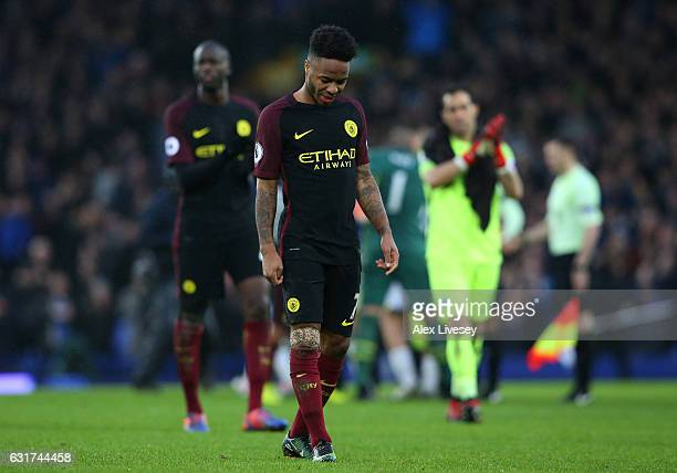 A dejected Raheem Sterling of Manchester City walks off the pitch following his team's 40 defeat during the Premier League match between Everton and...