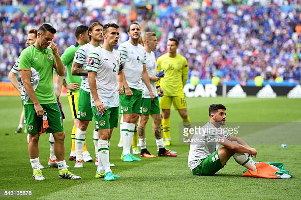 Dejected Republic of Ireland players including Seamus Coleman and Shane Long are seen in front of their supporters after their team's 1-2 defeat in...