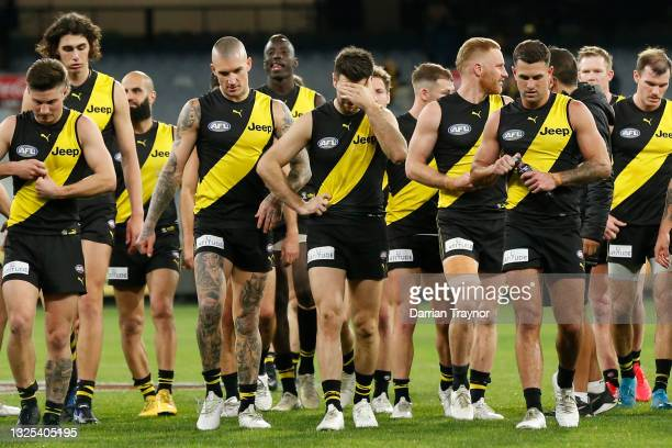 Dejected Richmond players walk off the ground after the round 15 AFL match between the Richmond Tigers and the St Kilda Saints at Melbourne Cricket...
