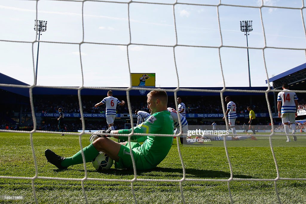 A dejected Robert Green of QPR sits on the floor after Cesc Fabregas of Chelsea scored the winning goal during the Barclays Premier League match between Queens Park Rangers and Chelsea at Loftus Road on April 12, 2015 in London, England.