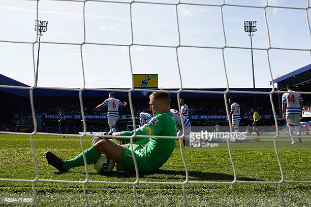A dejected Robert Green of QPR sits on the floor after Cesc Fabregas of Chelsea scored the winning goal during the Barclays Premier League match...