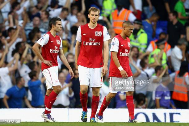 Dejected Robin van Persie, Per Mertesacker and Kieran Gibbs of Arsenal after defeat in the Barclays Premier League match between Tottenham Hotspur...