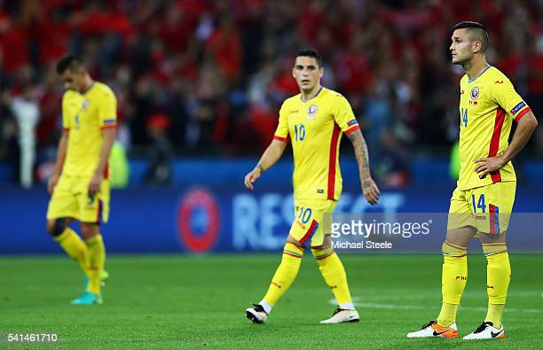 Dejected Romania players leave the pitch after their defeat in the UEFA EURO 2016 Group A match between Romania and Albania at Stade des Lumieres on...