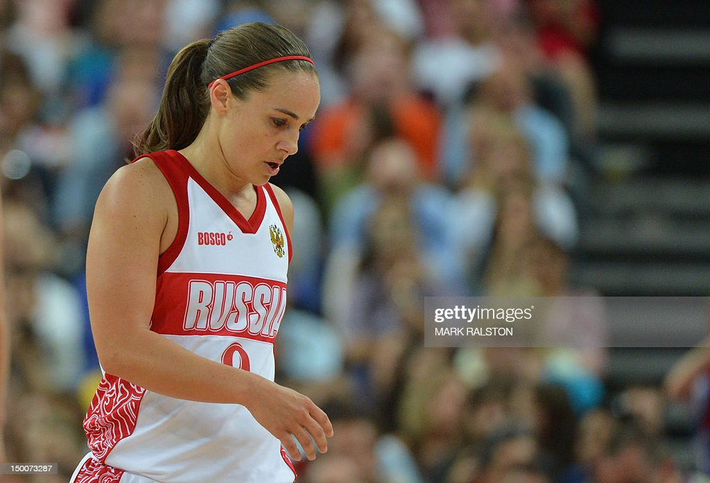 Dejected Russian guard Becky Hammon leaves the court after losing 81-64 to France during the London 2012 Olympic Games women's semifinal basketball game bewteen Russia and France at the North Greenwich Arena in London on August 9, 2012.