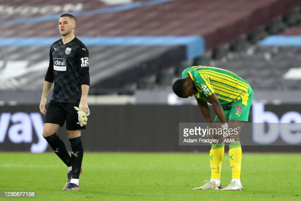 Dejected Sam Johnstone of West Bromwich Albion and Semi Ajayi of West Bromwich Albion reacts with hands on his knees at the final whistle after the...