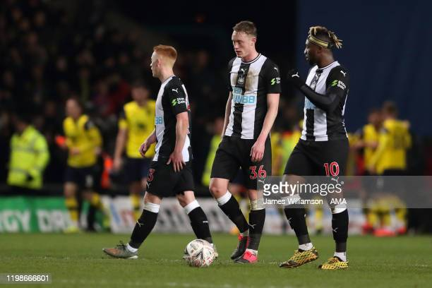 Dejected Sean Longstaff and Allan Saint-Maximin of Newcastle United after Nathan Holland of Oxford United scored a goal to make it 2-2 during the FA...