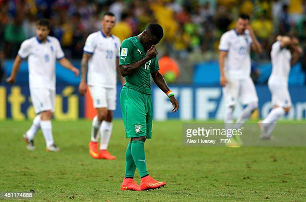 A dejected Serge Aurier of the Ivory Coast looks on after being defeated by Greece 21 during the 2014 FIFA World Cup Brazil Group C match between...
