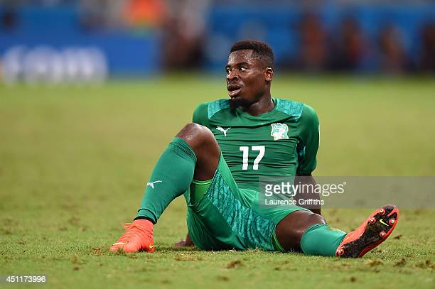 A dejected Serge Aurier of the Ivory Coast looks on during the 2014 FIFA World Cup Brazil Group C match between Greece and the Ivory Coast at...