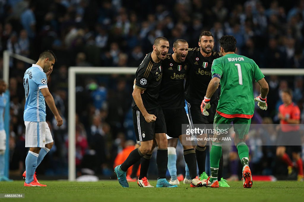 A dejected Sergio Aguero of Manchester City as Juventus celebrate their 1-2 victory at the end of the UEFA Champions League Group D match between Manchester City FC and Juventus at the Etihad Stadium on September 15, 2015 in Manchester, United Kingdom.