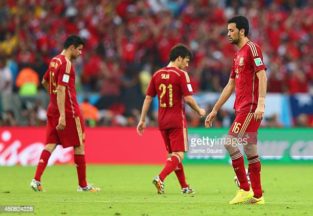 A dejected Sergio Busquets of Spain looks on during the 2014 FIFA World Cup Brazil Group B match between Spain and Chile at Maracana on June 18 2014...