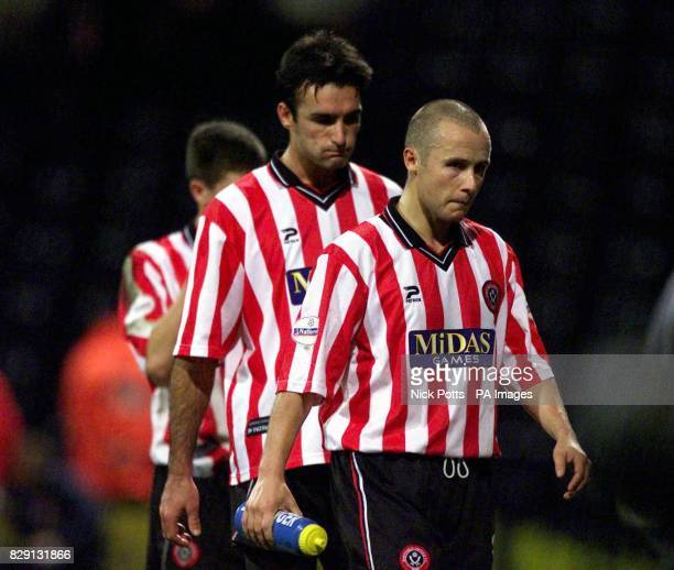 Dejected Sheffield United's Paul Devlin and Shaun Murphy walk off Deepdale pitch after 3 goal defeat during the Nationwide Division One match at...