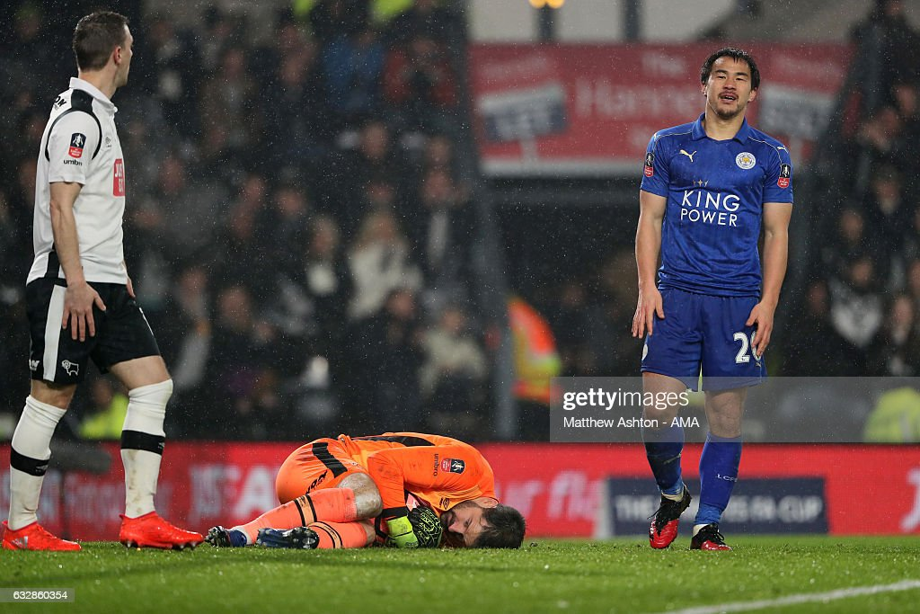 A dejected Shinji Okazaki of Leicester City as Scott Carson of Derby County saves at his feet during the Emirates FA Cup Fourth Round match between Derby County and Leicester City at iPro Stadium on January 27, 2017 in Derby, England.