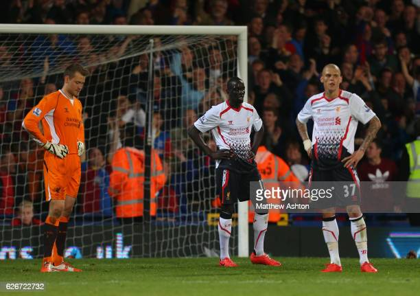 A dejected Simon Mignolet Mamadou Sakho and Martin Skrtel of Liverpool after Crystal Palace score to make it 33