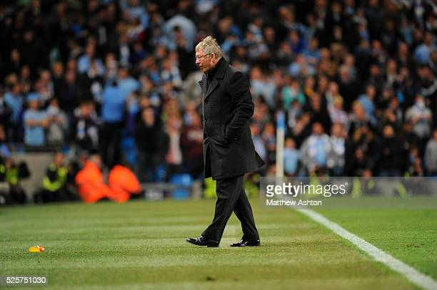 A dejected Sir Alex Ferguson the head coach / manager of Manchester United