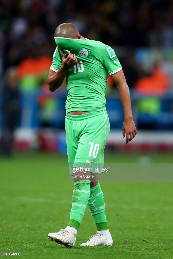 A dejected Sofiane Feghouli of Algeria wipes his face after being defeated by Germany 2-1 during the 2014 FIFA World Cup Brazil Round of 16 match between Germany and Algeria at Estadio Beira-Rio on June 30, 2014 in Porto Alegre, Brazil.