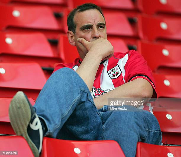 Dejected Southampton fan is pictured after seeing his team relegated from the Premiership after the Barclays Premiership match between Southampton...